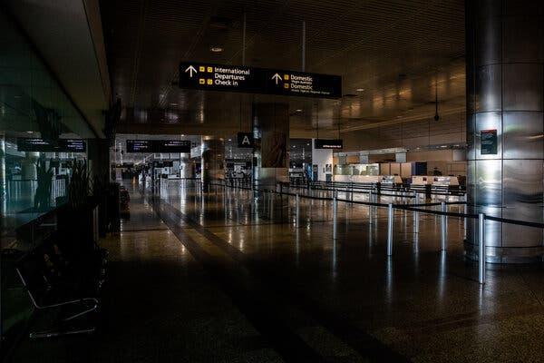Un aéroport de Melbourne vide en Australie le mois dernier. Les citoyens australiens bloqués en Inde ne sont pas autorisés à rentrer chez eux.